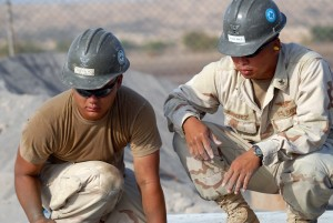 080112-N-0260R-006 OBOCK, Djibouti (Jan. 12, 2007) Builder 2nd Class Johan Sanchez and Steel Worker 3rd Class Andrew Heffron, both assigned to Naval Mobile Construction Battalion (NMCB) 40, work at a building construction site in Obock. NMCB-40 is building a slaughterhouse for the community as part of a Combined Joint Task Force - Horn of Africa civil action project. U.S. Navy photo by Mass Communication Specialist 1st Class Brandon Raile (Released)